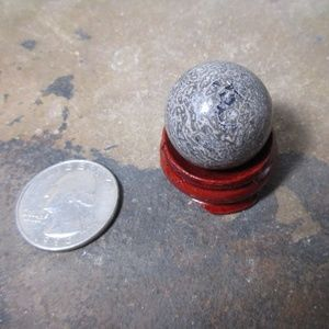1717 25 mm Dinosaur bone sphere with wood stand